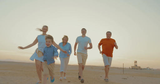 Boy is a winner of family race outdoor Footage