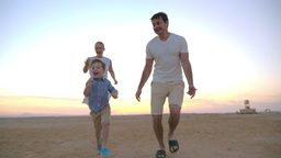 Parents having happy time with child on the beach Footage