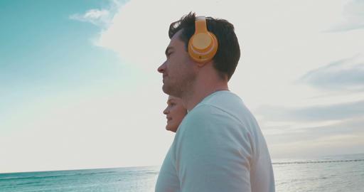 People in Headphones Listening to Music Footage