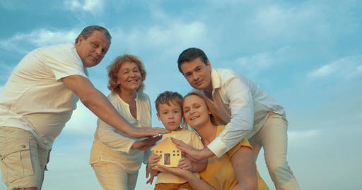 Family taking care of small wooden house Live Action