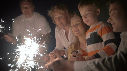 Mother and son with sparklers at night Footage