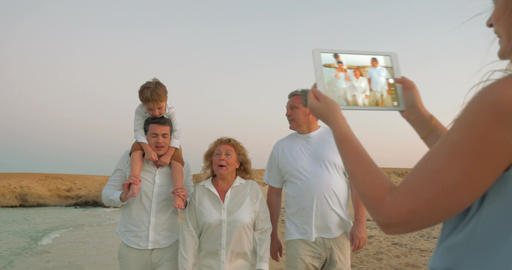 Using pad to take shots of family on vacation Footage