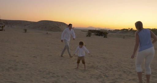 Family Playing Football On A Beach stock footage