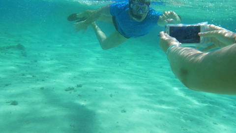 Taking smartphone underwater to get a nice shot Footage
