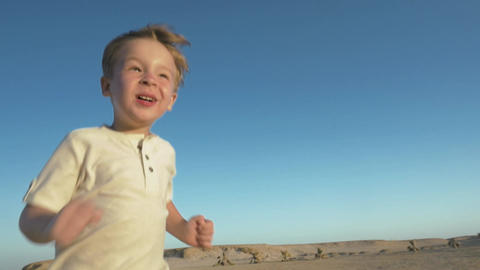 Little child running to his father on the beach Footage