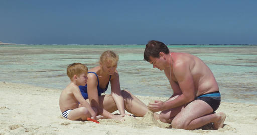 Young Family Building Sand Castle Footage