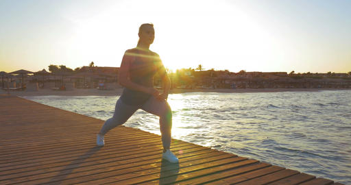 Young Woman Doing Lunge Exercise Footage