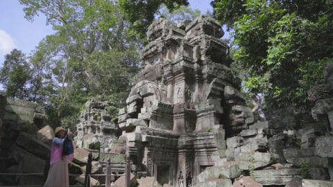 tourists take picture inside Siem Riep temple Footage