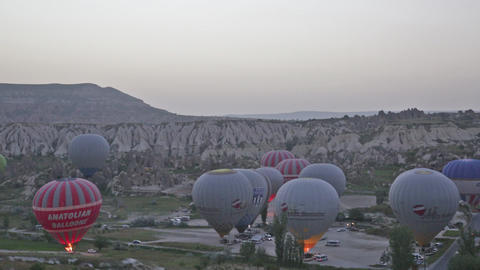 Balloons prepare for take-off before sunrise Footage