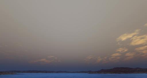 4k cloud flying over lake & wilderness at dusk Footage
