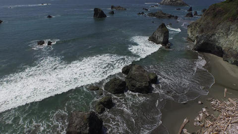 Aerial wide shot slowly moving over a rocky coastline Live Action