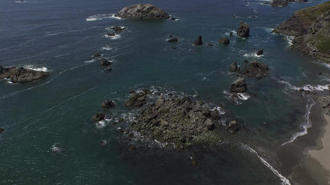 Aerial view of a rocky coastal beach Live Action