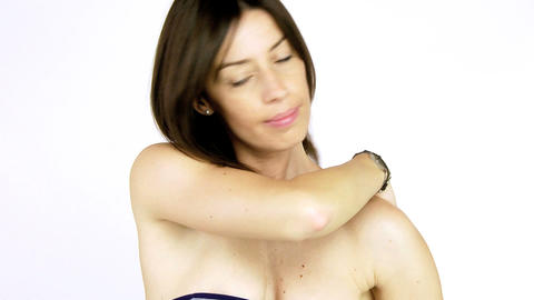 Beautiful female model in bikini Closeup putting Sun cream Stock Video Footage