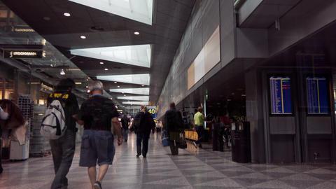 Passengers walking through terminal airport Vantaa Stock Video Footage