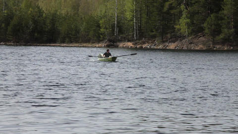 Rowing Boat Floats on the Lake Stock Video Footage
