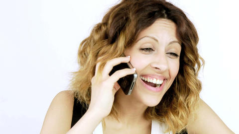 Medium shot of Happy laughing woman talking on the phone Stock Video Footage