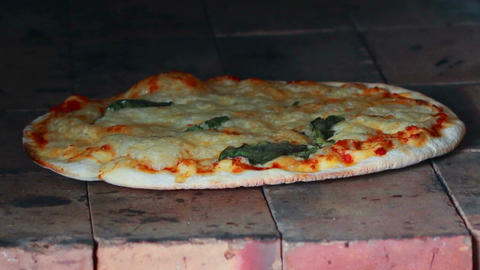 HD Footage close up of Pizza baked in a stone oven Footage