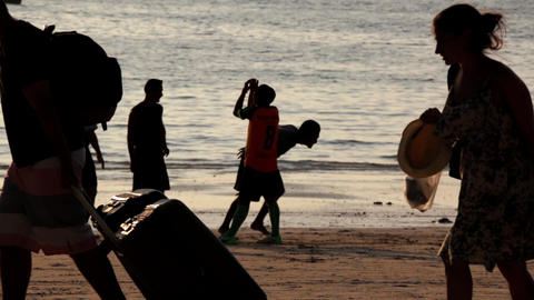 Group of boys playing beach soccer at a beach in Ao Nang, Thailand Live Action