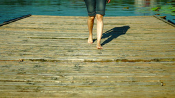 Bare Foot On Wooden Pier.Girl In Shorts Walking On A Wooden Bridge Footage