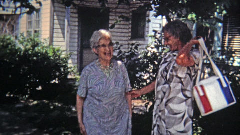 1971: Old women childhood friends sharing embrace and laughter Live Action