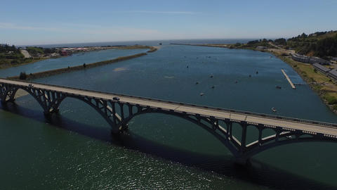Aerial view moving over a concrete bridge in oregon Footage