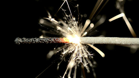 Closeup of Sparkler lit by Hand Footage