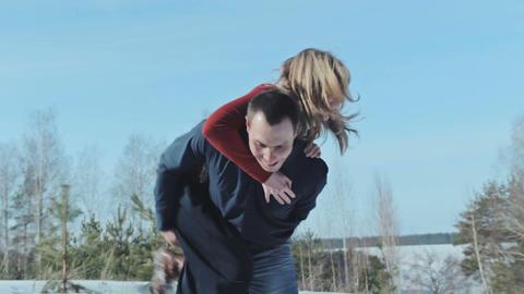 Funny girl jumps on boyfriend back Footage