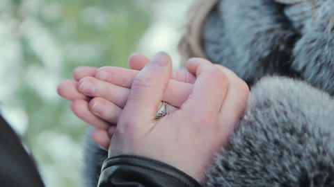 boyfriend warms hands sweetheart, frozen in the cold Stock Video Footage