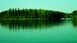Lacustrine Landscape.Green Forest Reflections On Rippling Lake Waters Footage