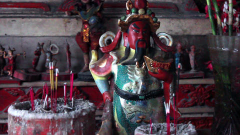 Old figurine of deified Chinese historical character Footage
