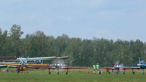 YAK-52 sport planes preparing for take-off Footage