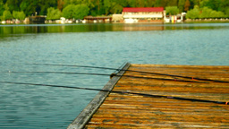 Rods On Wooden Pier, Pan Footage