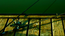 Rods On Wooden Pier,Turquoise Water, Pan Footage