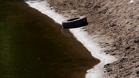 Car Tire On The River Edge stock footage