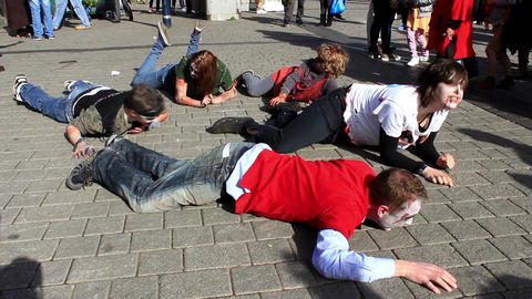 Lying zombies crawling around and looking for another victims ビデオ