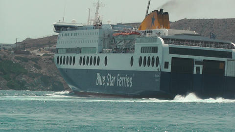 Blue Star ferry boat turning as it leaves the port Footage