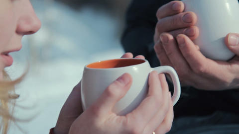 Young Couple In Love On A Winter Vacation Enjoying The Nature And Drinking Hot T stock footage