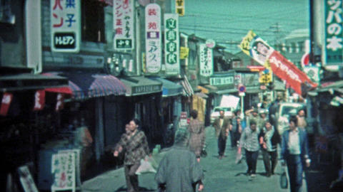 1972: People shopping at outdoor Japanese marketplaces and city streets Footage