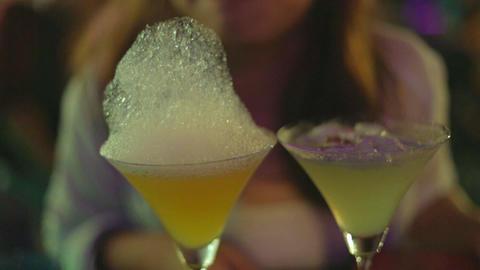 girl licks foam off of alchemy martini - Myanmar nightlife Footage