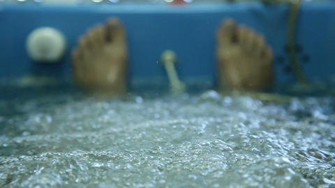 Man lies in the treatment bath in a spa Footage