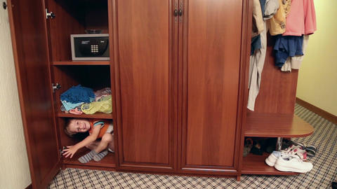 The boy is hiding in the closet Footage
