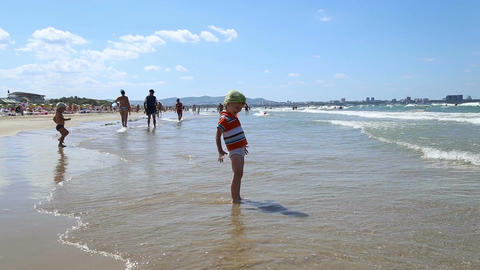 Little boy happily goes to sea Footage