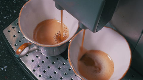 Coffee Machine Making Espresso into a Two Cap Footage