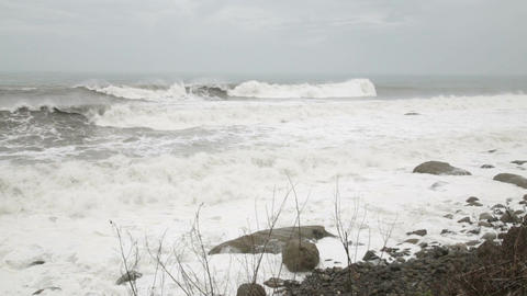 Stormy sea during a typhoon waves crashing on rocks Footage