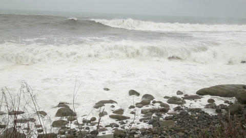 Stormy Sea During A Typhoon Waves Crashing On Rocks Panning stock footage