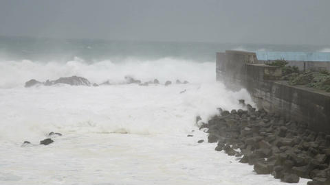Stormy Sea Waves Crashing Against Barrier Wall During Typhoon stock footage