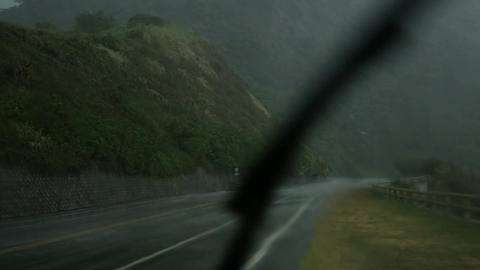 Heavy rain from inside car with windscreen wiper going Footage
