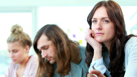 Daydreaming casual businesswoman between colleagues Footage