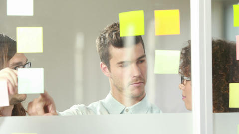 Casual business team brainstorming with sticky notes Footage