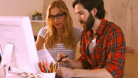 Casual Designers Working On A Photo Catalog stock footage